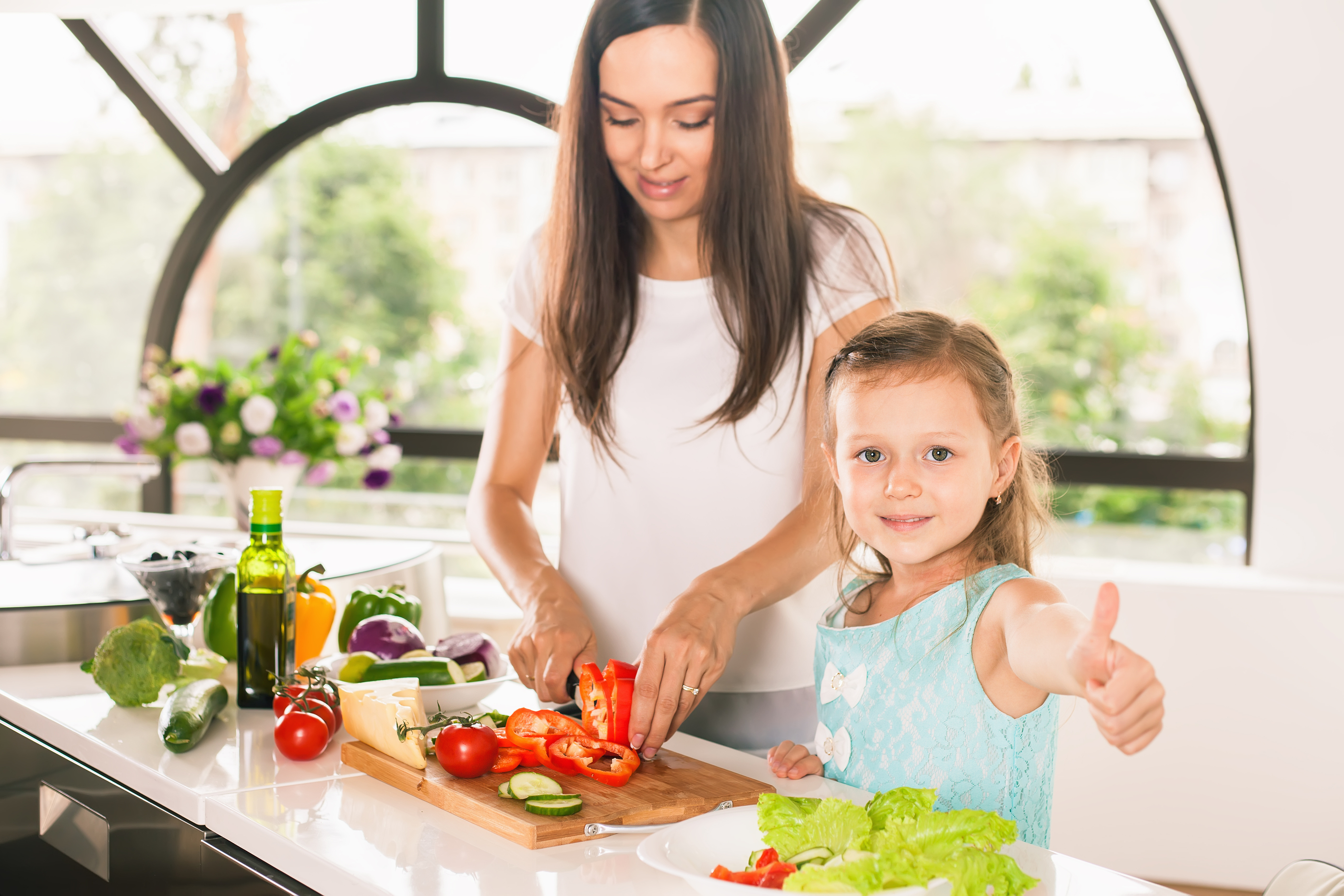 mom with daughter in kitchen