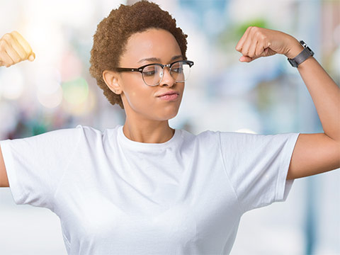A women flexing her arm